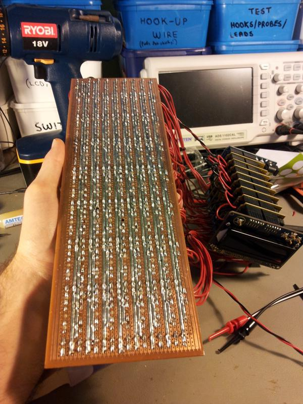 The bottom-side of the prototype board, fully soldered. Notice the heavy duty rails that deliver the power to the relays/solenoids. Even with these thick lines of solder, when half (31) of the solenoids where turned on, the board got considerably warm around the PSU entry point.