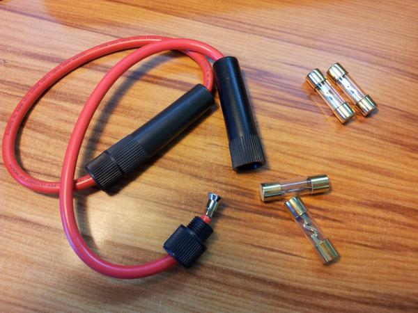 The heavy duty fuses used to protect the +12V rails of the power supply. The two in use are 30A 5AG fuses, and the two spares are 40A.