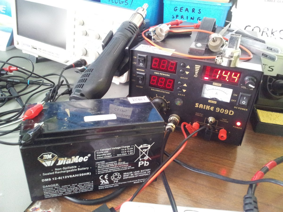 Charging a 12V, 6Ah lead-acid battery with a variable-voltage power supply.