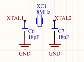 A schematic of a crystal, usually connected to a microcontroller or other digital device that uses a clock. The load capacitance usually varies from 6-25pF per leg (see the crystals datasheet for the correct value).