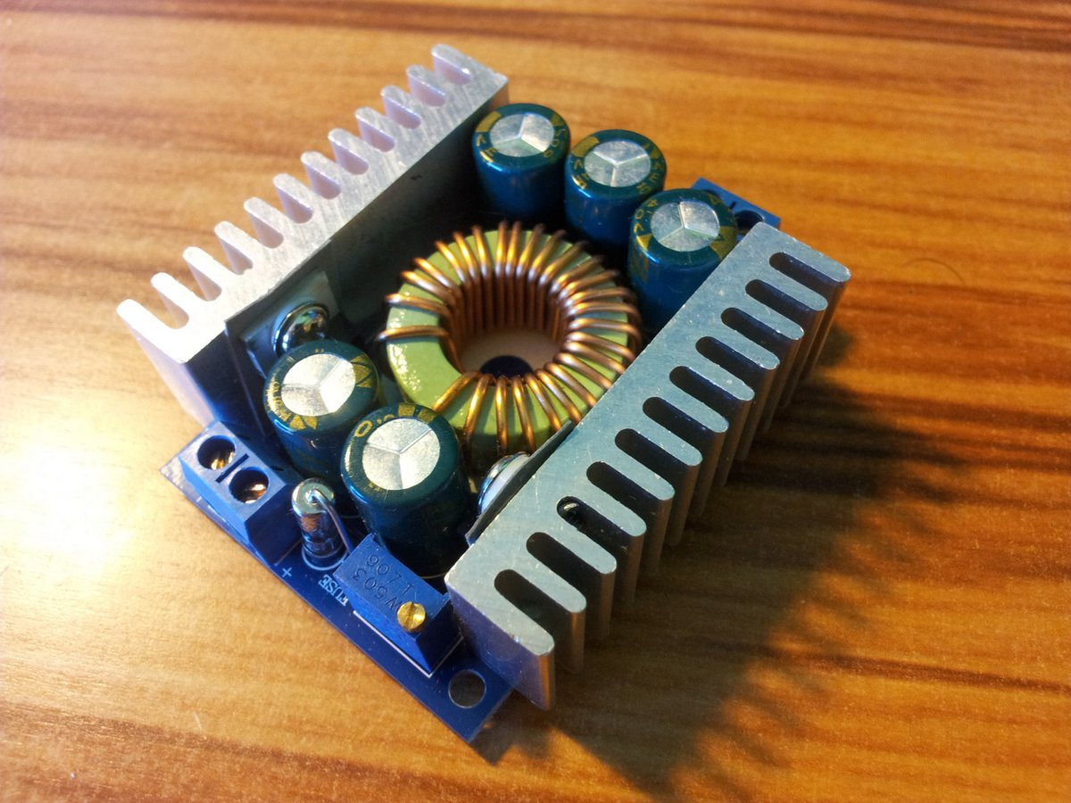 A 12A, 4.5-30V in, 0.8-28V out DC-DC buck converter from AliExpress. Rated power is 100W without active cooling, 200W with active cooling.