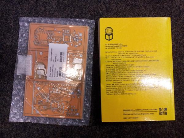 This photo shows the gross orange colour of the electric skateboard PCBs compared to the kind of yellow I was expecting.